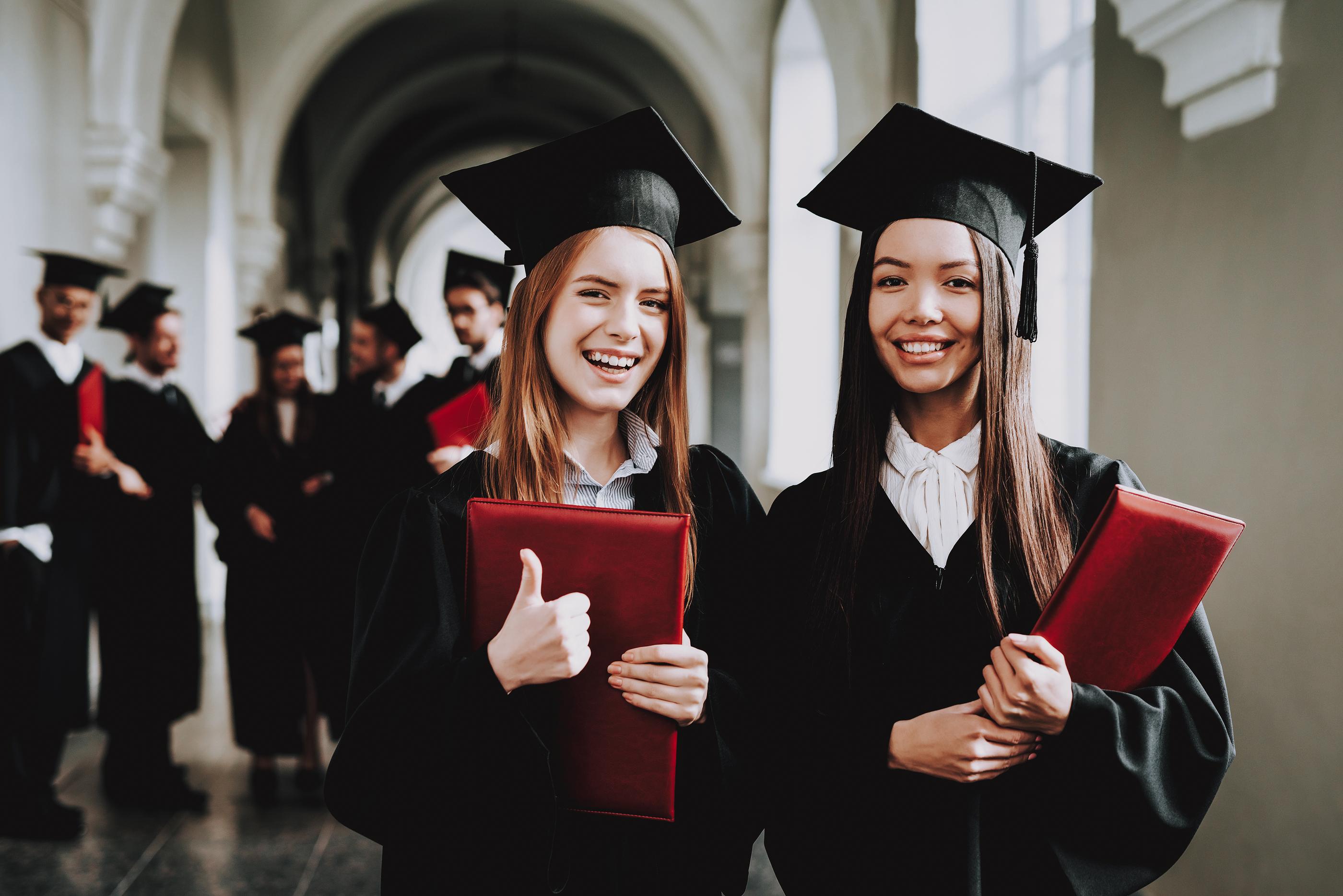 two young women graduating